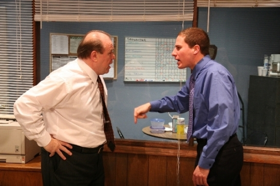 Craig Spidle and Ian Forester as used car salesmen arguing over acommission