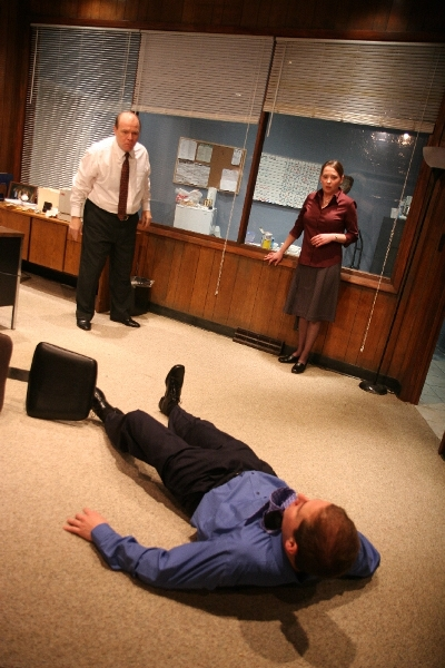Kathy Logelin and Ian Forester (on floor) as used car salespersons having a toughtime