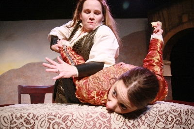 Diana (Stephanie Repin) and her sister Isabel (Meghan M. Martinez) work through a disagreement