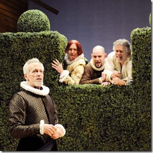 In one of Shakespeare's most famous comic scenes, Malvolio (Larry Yando, left), believing he has found a love letter from his mistress Olivia, fantasizes about his life as her husband, to the amusement of the eavesdropping Sir Andrew Aguecheek (Dan Kenney), Fabian (Dan Sanders-Joyce), and Sir Toby Belch (Scott Jaeck). In the years after the play premiered, the character of Malvolio was so popular that the play was often titled Malvolio and abridged to feature him.
