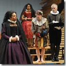 Under the watchful eye of her household steward Malvolio (Larry Yando, right), and her gentlewoman Maria (Ora Jones, second from left), Olivia (Karen Aldridge, left) listens to the clown Feste (Ross Lehman, second from right) as he tries to make her laugh. The forces of rule—the denial of desire and the refusal of ordinary pleasure, as represented by Malvolio—suit Olivia in her mourning.