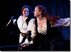Murderer (Stephanie Repin) and Lady Macduff (Rachel Stubbs) struggle to the death.