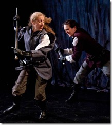 Macduff (Amy E. Harmon) and Macbeth (Kathrynne Wolf) face the final conflict.
