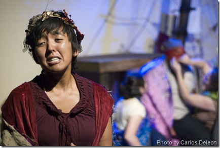 Hecuba (Samantha Garcia) grieves the death of her daughter