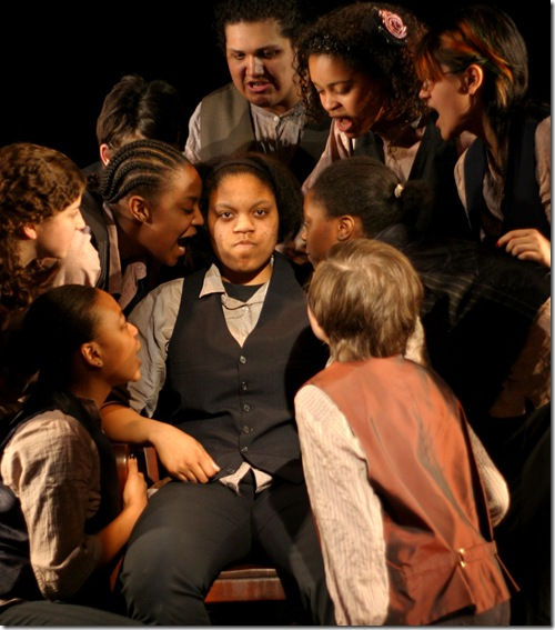 Amber Smith as Abe, and ensemble. Photo credit: Anita Evans