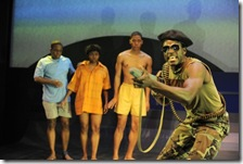 (front, w/gun) Adeoye plays a Sudanese guerrilla fighter, who confronts three Lost Boys (rear, from left) T-Mac Sam (Samuel G. Roberson, Jr.), K-Gar Ollie (Leslie Ann Sheppard), and A.I.Josh (Namir Smallwood) in Victory Gardens Theater's Chicago premiere of The Lost Boys of Sudan (photo: Liz Lauren)