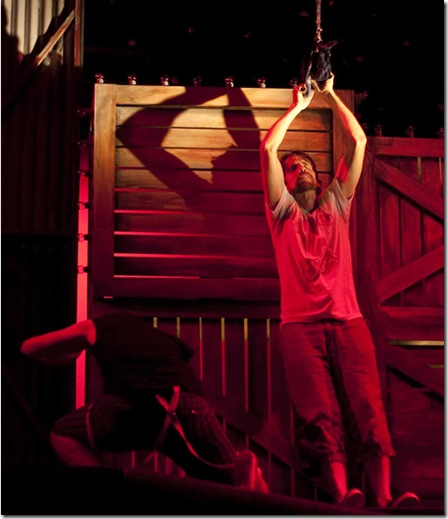 Jesus being crucified: Syler Thomas as Jesus in GODSPELL, running through September 26 at 1001 W. Roosevelt Road, Chicago, IL.