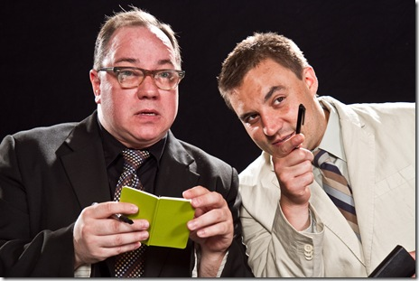 (L to R) Birdboot (Jon Steinhagen) and Moon (Philip Winston) write their reviews of the play during the play, Signal Ensemble Theatre's inaugural production in their new venue   Photo by Johnny Knight.