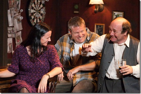 from left, Valerie (Sarah Wellington), Jim (Jeff Christian), and Jack (Brad Armacost) have great craic in Seanachaí Theatre Company's THE WEIR by Conor McPherson. Photo courtesy of Eileen Molony.