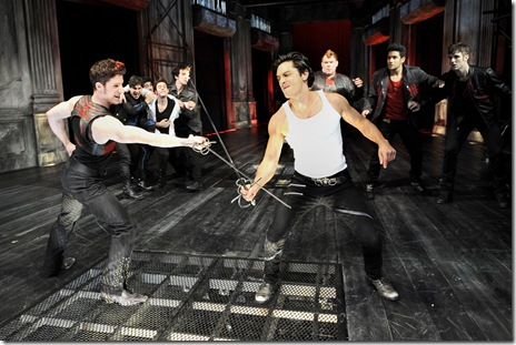 Tybalt (Zach Appelman, left) duels Mercutio (Ariel Shafir) as the Montagues restrain Romeo from interfering.  Photo by Liz Lauren.