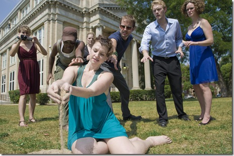 "Antigone (Anna Carini, foreground) illegally burries her brother despite the opposition of her family and the people (standing, from left to right, Dominica Fisher as Chorus, Ebony Wimbs as Jones, Calliope Porter as Eurydice, Jeremy Fisher as Barnes, Brett Schneider as Haemon and Cyd Blakewell as Ismene), in SiNNERMAN Ensemble's Midwest premiere of ""Too Much Memory,"" Keith Reddin and Meg Gibson's explosive contemporary adaptation of the Greek Antigone tragedy, directed by Anna C. Bahow, October 7-November 13, 2010. Photo by Kevin Viol."