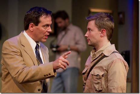 Wagner (Shawn Douglass) gives Milne (Greg Matthew Anderson) a lesson in the ethics of journalism in Remy Bumppo Theatre Company's production of Tom Stoppard's Night and Day, Sept. 22 through Oct. 31 at the Greenhouse Theater Center, 2257 N. Lincoln Ave.  Tickets at www.remybumppo.org or 773-404-7336. Photo by Johnny Knight.