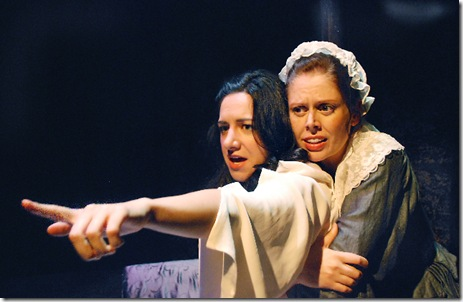 "Nelly (Cameron Feagin, right) comforts Cathy (Lindsay Leopold, left), who suffers from tortured visions; in Lifeline Theatre's world premiere production of ""Wuthering Heights,"" adapted by Christina Calvit, directed by Elise Kauzlaric, based on the classic novel by Emily Brontë"