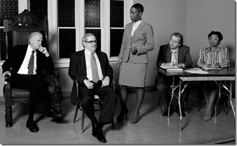 "left to right are Rob Riley, AEA (as Judge Barnes), Bernie Beck, AEA (as defendant Arthur Golden), Shariba Rivers (as the defendant's lawyer Ms. Allen), Steven Pringle (as the plaintiff's lawyer Mr. Lawton), and Jacquie Coleman (as plaintiff Regina Wade), in Todd Logan's ""Defamation,"" a Canamac Productions world premiere courtroom drama in a limited run at three Evanston, Illinois, houses of worship, directed by Richard Shavzin.  In the scene pictured defendant Golden is on the witness stand being questioned by his attorney, Ms. Allen."