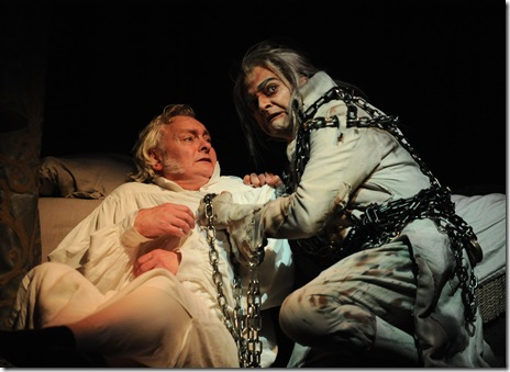 Ebenezer Scrooge (John Judd) and Jacob Marley (Anish Jethmalani)