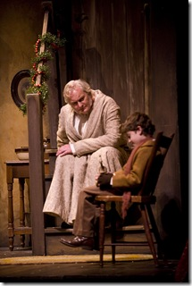 Ebenezer Scrooge (John Judd) and Tiny Tim