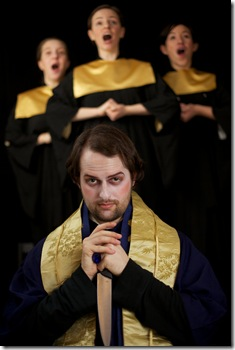 Jeffrey Fauver as choir director in 'Escape from the Haltsburg Boys Choir' - Ruckus Theater. Photo by Lucas Gerald