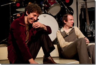 "(left to right) Bill (Nathan Drackett) and Charlie (Bries Vannon) laugh at the rest of the band during an interview, in Signal Ensemble Theatre's world premiere of the drama with music ""Aftermath""."