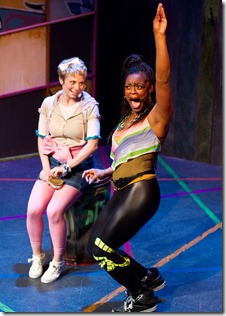 Hero (Jillian Burfete) learns how to be a diva from MC Lady B (Ericka Ratcliff), in Chicago Shakespeare Theater's Funk It Up About Nothin' at Chicago Shakespeare Theater. Photo by John W. Sisson Jr.