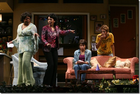 Iris (Karen Aldridge) (center couch) returns home to find nothing has changed in the past 17 years as (l to r) Daisy (Jacqueline Williams), Rose (Penny Johnson Jerald) and Jasmine (Christiana Clark) dance around the house. Photo by Eric Y. Exit