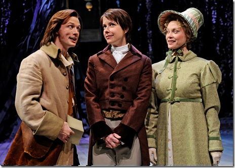 Disguised as the young man Ganymede, Rosalind (Kate Fry, center) listens to Orlando (Matt Schwader) unwittingly proclaim his love for her as Celia (Chaon Cross) looks on in amusement, in Chicago Shakespeare Theater's 'As You Like It'. Photo by Liz Lauren.