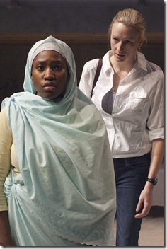 Hawa (Mildred Marie Langford, left) is reluctant to share the story of what has happened to her with New York Times reporter Maryka (Kelli Simpkins, right) in TimeLine Theatre's Chicago premiere of IN DARFUR by Winter Miller, directed by Nick Bowling. Photo by Lara Goetsch.