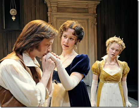 Orlando (Matt Schwader) surprises Rosalind (Kate Fry) with a kiss after she and Celia (Chaon Cross) praise his wrestling victory at Court, in Chicago Shakespeare Theater's 'As You Like It'. Photo by Liz Lauren.