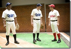 Pictured (from left)  Kamal Angelo Bolden as Jackie Robinson, Sean Cooper as Jackie's Dodger teammate Pee Wee Rees, and Patrick De Nicola as Phildelphia Phillies manager Ben Chapman. Photo credit:  Michael Brosilow