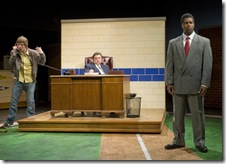 Pictured, from left:  Tyler Ross as Joey Stoshack, Charles Stransky as Branch Rickey, president and general manager of the Brooklyn Dodgers,  who signed the first African-American to play major league baseball, Jackie Robinson, played by Kamal Angelo Bolden. Photo credit:  Michael Brosilow