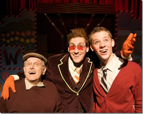 Charlie's father, Willie Wonka and Charlie in 'Charlie and the Chocolate Factory' at Emerald City Theatre Chicago.