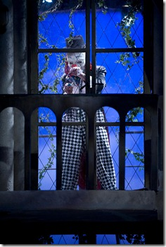 Lance Baker as clown breaking in - a scene from Theatre at the Center's 'Sleuth'.  Photo by Michael Brosilow.