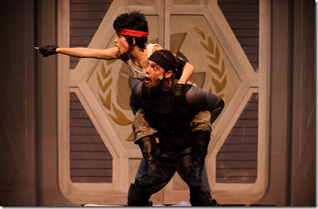 Taz (Lauren Lopez) and Up (Joe Walker) take off into battle in StarKid's new comedy musical Starship, now playing in Chicago's Center on Halsted.  Photo credit: Chris Dzombak.