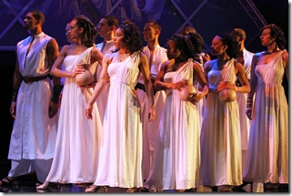 'Aida' group in white in Elton John and Tim Rice's Tony Award-winning musical AIDA at Drury Lane Theatre Oakbrook Terrace. Photo credit: Brett Beiner.