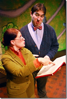 "Mean Mrs. Plute (Julia Merchant, left) informs Mr. Bing (Anthony Kayer, right) that the bylaws of their condo community demand that Arnie the doughnut must go by the end of the day; in Lifeline Theatre's production of ""Arnie the Doughnut,"" adapted by Frances Limoncelli, music by George Howe, and directed by Elise Kauzlaric, based on the popular children's book by Laurie Keller. Photo by Suzanne Plunkett."