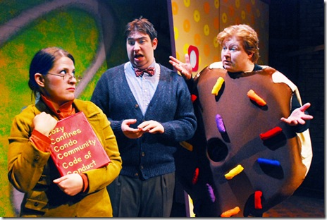 "Mr. Bing (Anthony Kayer, center) and Arnie the doughnut (Brandon Paul Eells, right) plead with Mrs. Plute (Julia Merchant, left) to let Arnie stay at the Cozy Confines Condo Community; in Lifeline Theatre's production of ""Arnie the Doughnut,"" adapted by Frances Limoncelli, music by George Howe, and directed by Elise Kauzlaric, based on the popular children's book by Laurie Keller;  Photo by Suzanne Plunkett."