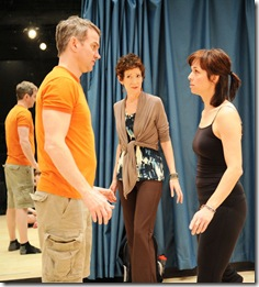 Carmen Roman looks on as 2 of her students go through an acting exercise in Victory Garden's 'Circle Mirror Transformation'.