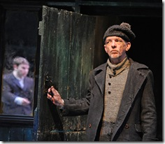 Druid The Cripple of Inishmaan. Liam Carney, Tadhg Murphy in mirror reflection. Photo by Robert Day.