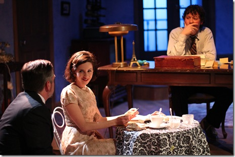 Jacques (Robert McLean) woes Chloe (Madeline Long) as Vincent (Joel Ewing) observes in Mat Smart's charming and theatrical play, The 13th of Paris