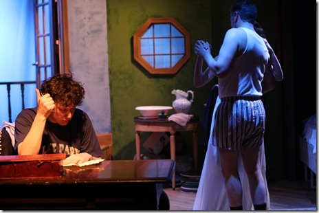 Vincent (Joel Ewing) attempts to write from the heart as Jacques (Robert McLean) and Chloe (Madeline Long) share a dance in Mat Smart's charming and theatrical play, The 13th of Paris