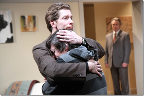 Martin (Nick Sandys) comforts son Billy (Will Allan) in a moment of turmoil while family friend Ross (Michael Joseph Mitchell) looks on.