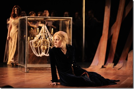 Anna Stephany as Medea, ensemble in background. Photo by Liz Lauren