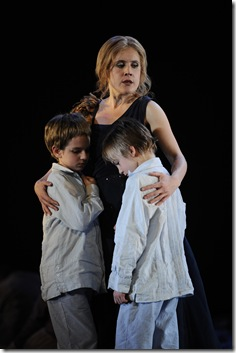 Anna Stephany, as Medea, stands with her 2 children. Photo by Liz Lauren.