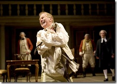 King George III (Harry Groener) embraces his straitjacket as he struggles to regain control of his mind in Chicago Shakespeare Theater's The Madness of George III. Photo by Liz Lauren.