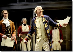 King George III (Harry Groener, center) handles government affairs with Prime Minister William Pitt (Nathan Hosner, far left) as Fortnum (Mark D. Hines) awaits orders, in Chicago Shakespeare Theater's The Madness of George III. Photo by Liz Lauren.