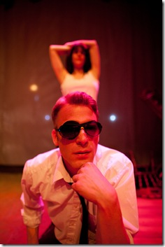 "FBI Man (Sorin Brouwers) and Trevor (Lucy Carapetyan) perform the ""We Sense Each Other Dance"" in Dog & Pony Theatre Company's Midwest premiere production of Roadkill Confidential by Sheila Callaghan. Photo Timmy Samuel"