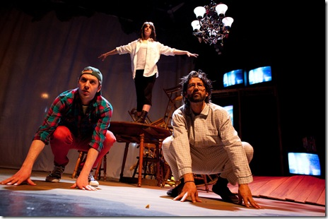 "L to R: Randy (Andrew Goetten), Trevor (Lucy Carapetyan on table) and William (Dan Smith) flashback to fame time in Dog & Pony Theatre Company's Midwest premiere production of ""Roadkill Confidential"" by Sheila Callaghan. Photo: Timmy Samuel"