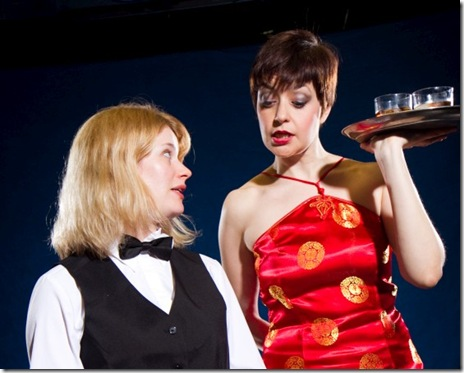 "Samantha (Simone Roos, left) shows Linda (Elizabeth Bagby, right) her dealing tricks, in Signal Ensemble Theatre's world premiere of ""Aces"" by ensemble member Jon Steinhagen, directed by Ronan Marra, opening May 14, 2011, 8 p.m., and running Thursdays, Fridays and Saturdays at 8 p.m., and Sundays at 3 p.m., through June 18. (Photo: Johnny Knight)"