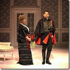 """Anita Hoffman (Desirée) and Jeremy W. Rill (Carl-Magnus) in Stephen Sondheim's """"A Little Night Music"""" at Circle Theatre in Oak Park."""