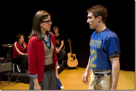 "Ellie Reed and Cameron Harms in Griffin Theatre's ""No More Dead Dogs"". (background: The Mangos)"