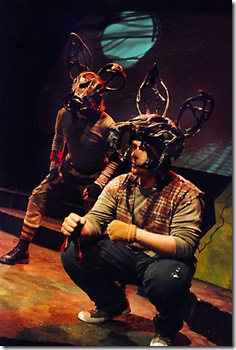 "As told in legend, El-ahrairah (Paul S. Holmquist, right), Prince of Rabbits, and Rabscuttle (Scott T. Barsotti, left) enter the burrow of the Black Rabbit of Inlé on a quest to save their people; in Lifeline Theatre's world premiere production of ""Watership Down,"" adapted by John Hildreth, directed by Katie McLean Hainsworth, based on the bestselling novel by Richard Adams. (Photo: Suzanne Plunkett)"